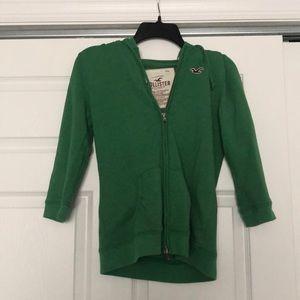 Green Hollister zip up.